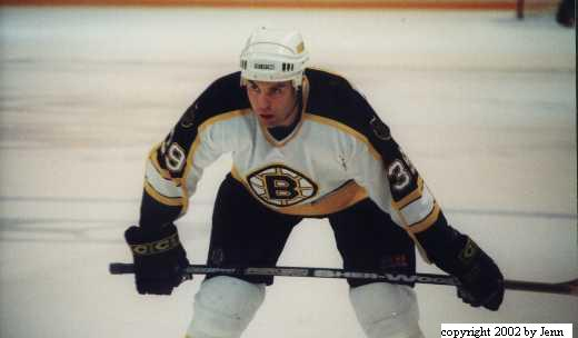 In game shot of Joel.  Playing for the Boston Bruins.
